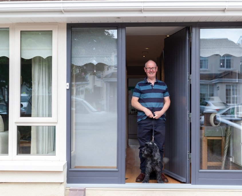 A happy Churchfield customer standing ourside his Deep Retrofit house.