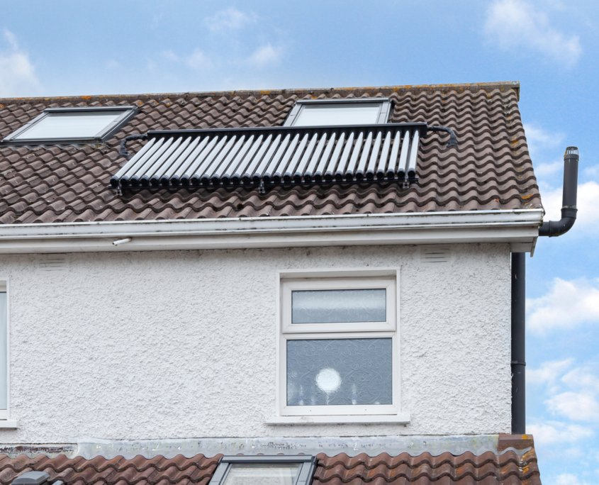 Solar thermal panels on top of a roof in Ireland