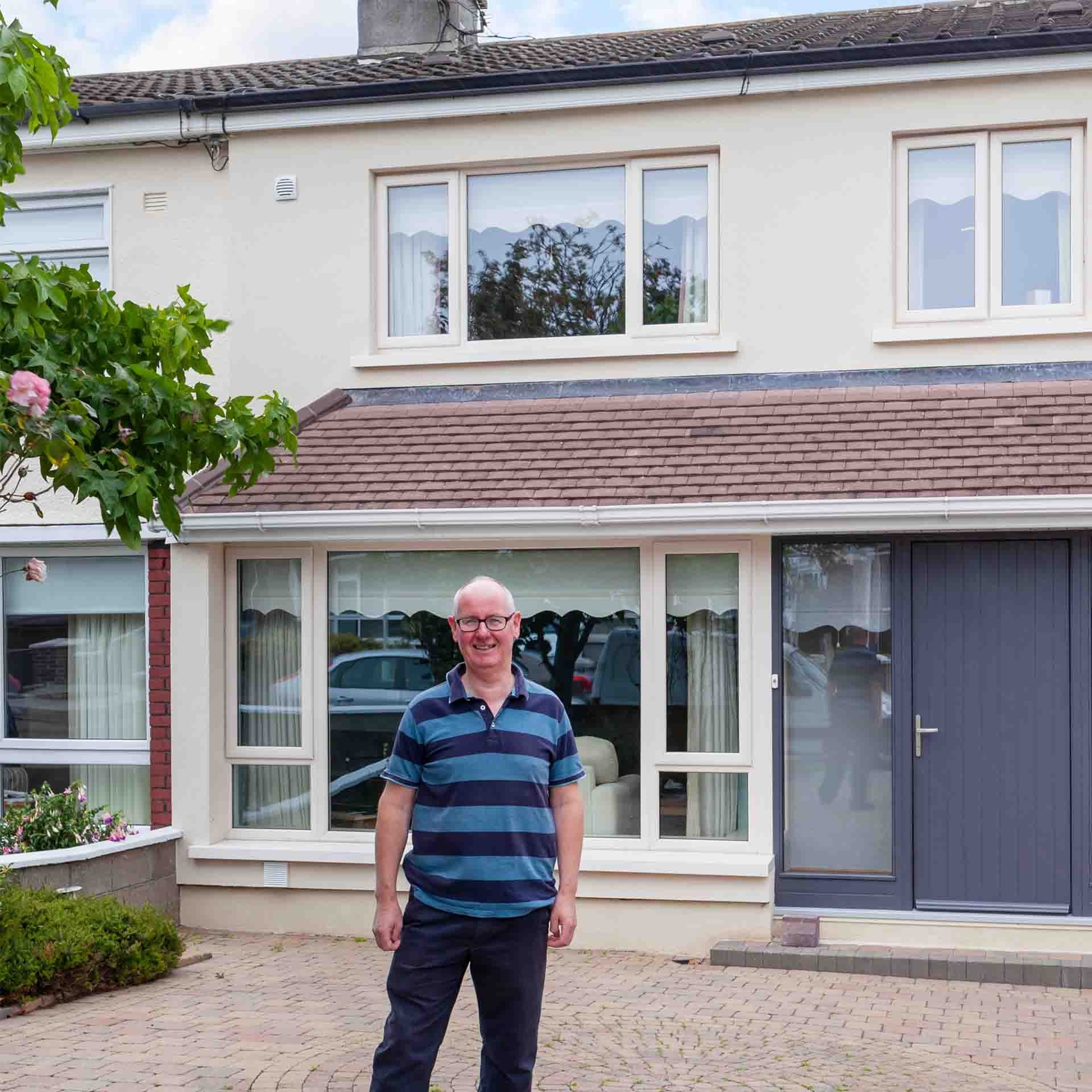 Man standing outside his Deep Retrofitted home in Dublin