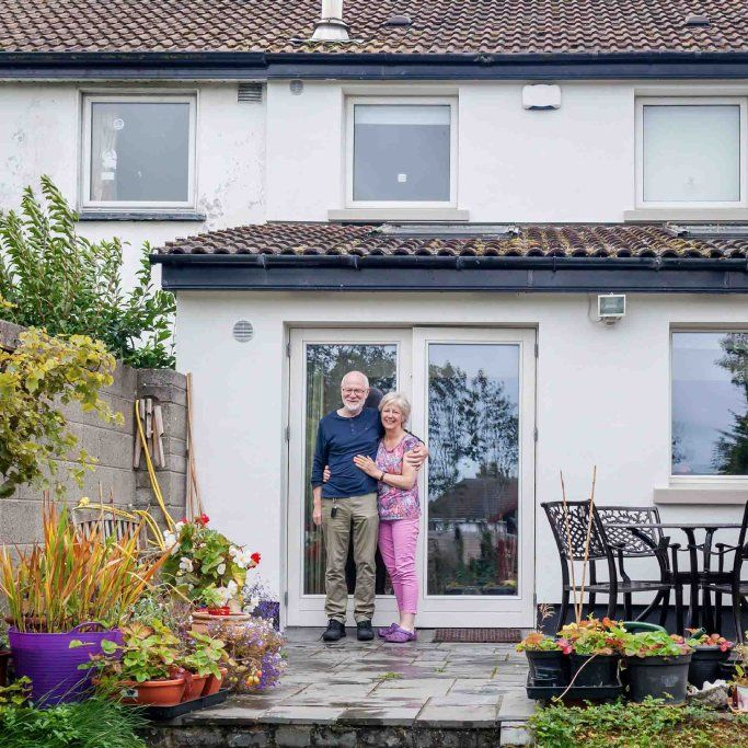 Happy coupe standing outside their Dublin home with external wall insulation