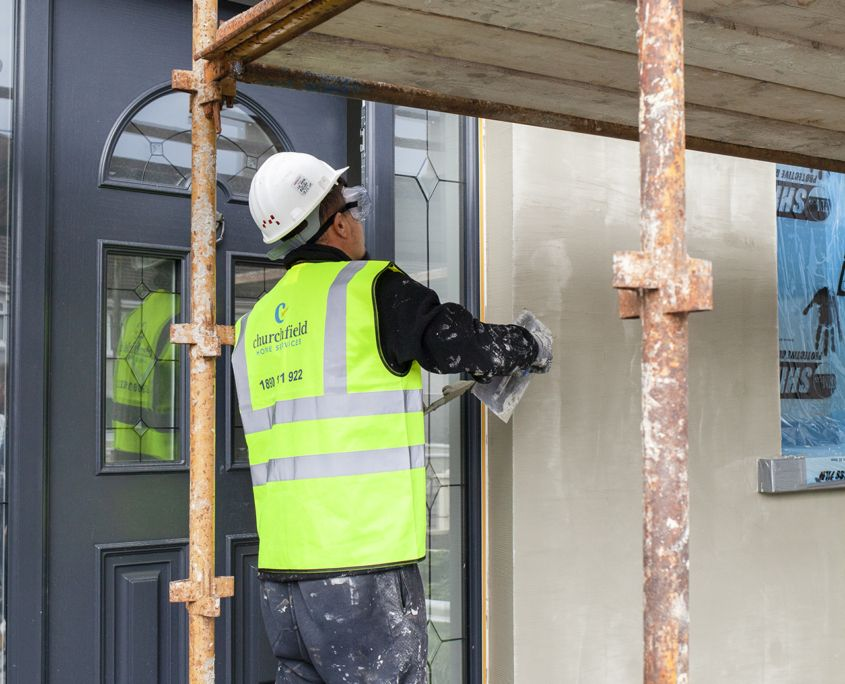 Man applying external wall insulation render