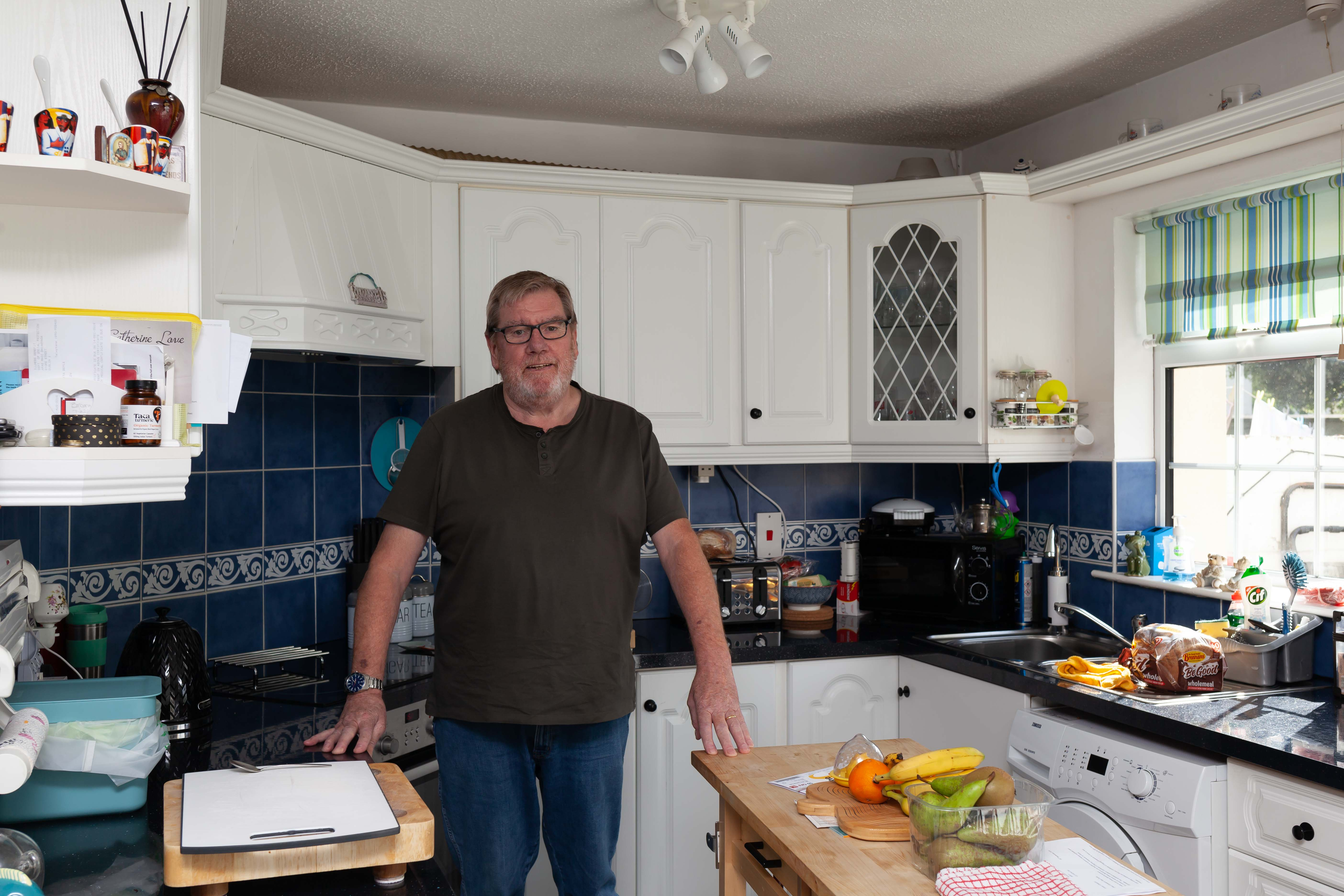 Man standing in kitchen with external wall insulation