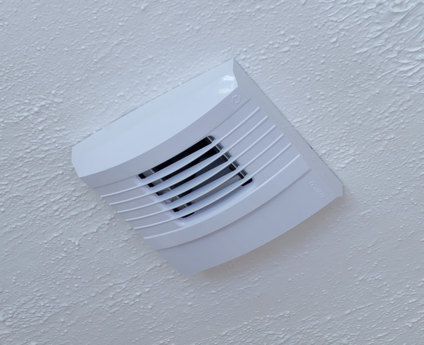 Demand control ventilation unit on a ceiling
