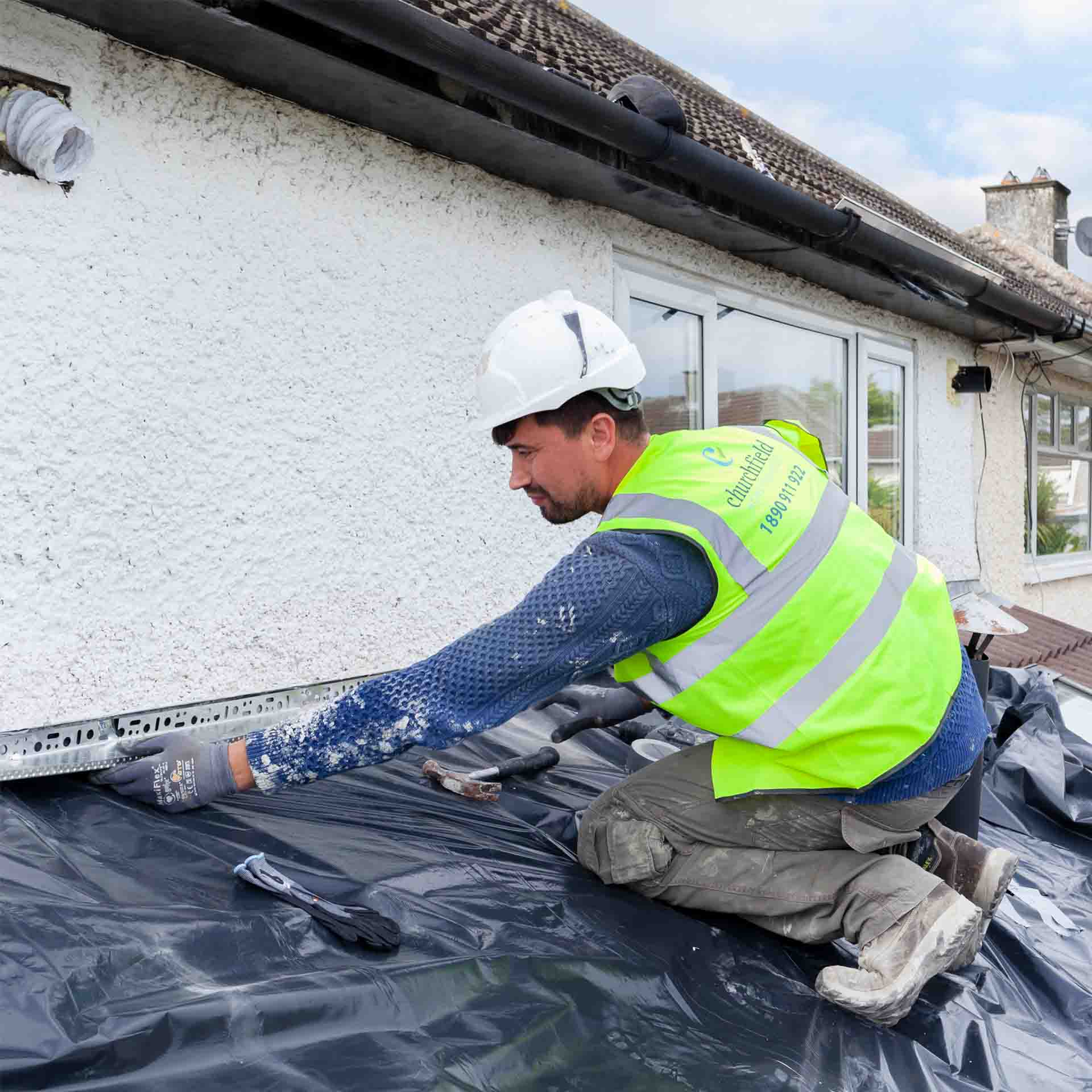 Contractor working on External Wall Insulation on an Irish house