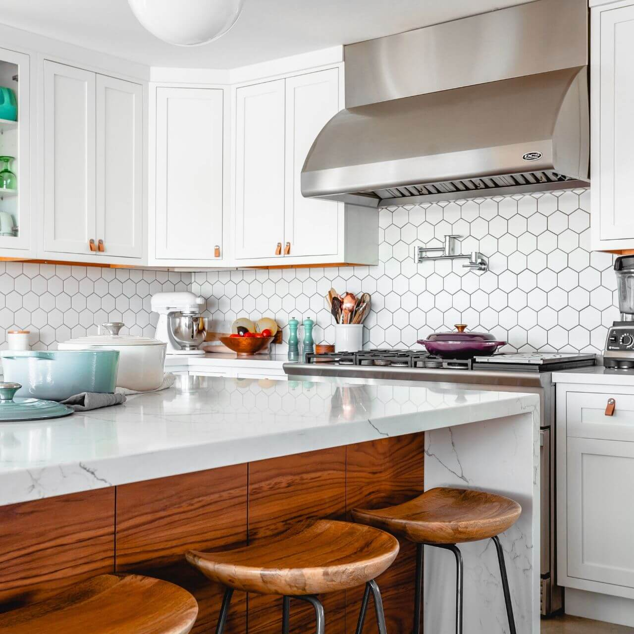 Bright modern kitchen with white tiles